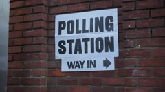 Polling Station Sign on Brick Wall with person towards Stock Footage