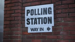 Polling Station Sign on Brick Wall with person away Stock Footage