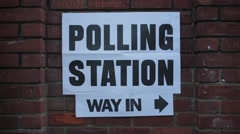 Polling Station Sign on Brick Wall Stock Footage
