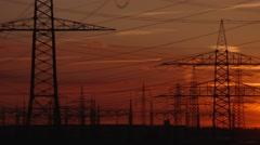 SUNDOWN: power poles in germany - stock footage