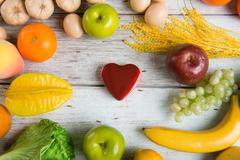 healthcare concept balance between medicine and healthy foods - stock photo