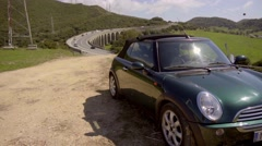 Car pulled over from highway Stock Footage