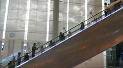 People using the escalator in Terminal 21 Shopping Mall Bangkok. Stock Footage