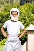 A kid dressed with a costume is watching the lens Stock Photos