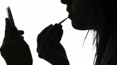 Woman applying lipstick Stock Footage