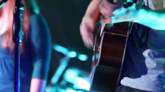 Guitarist playing an acoustic guitar - stock footage