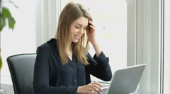 Businesswoman in office with laptop computer Stock Footage