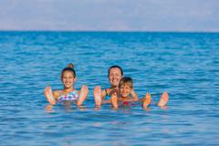 Family At The Dead Sea, Israel - stock photo