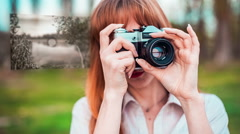 Girl taking photos with old film camera with hologram. Technology concept. Stock Footage