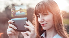 Girl shooting video with a smartphone camera with hologram Stock Footage