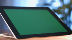Man working with a green screen on a tablet computer. Stock Footage