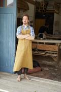 Portrait Of Carpenter Outside Bespoke Surfboard Workshop - stock photo