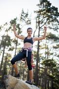 Woman succeed rock climbing Stock Photos