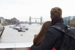 Couple Sightseeing In London Looking At Tower Bridge - stock photo