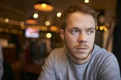 Young Man Sitting Alone In Bar Stock Photos