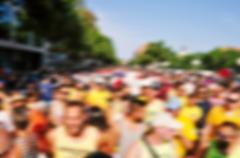 Defocused background of people partying or marching outdoors Stock Photos