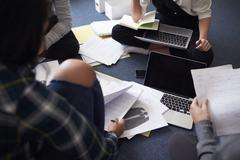 Group Of Students Collaborating On Project Together - stock photo