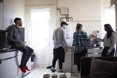 Group Of Students Hanging Out In Shared House Together Stock Photos