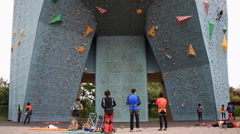 Time lapse of people climbing on artificial outdoor climbing wall Stock Footage