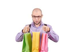 man  with colorful shopping paper bags - stock photo