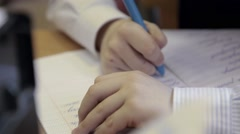 Primary school student writting  in the notebook - stock footage