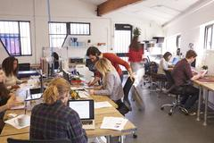 Interior Of Busy Design Office With Staff Stock Photos
