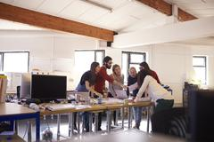Wide Angle Shot Of Designers Brainstorming In Office Meeting Stock Photos