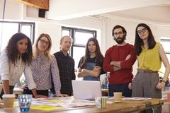 Portrait Of Design Team In Modern Office Stock Photos