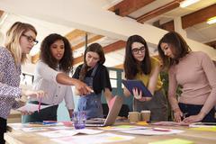 Female Designers Having Brainstorming Meeting In Office Kuvituskuvat