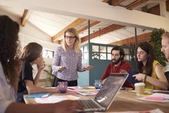 Female Manager Leads Brainstorming Meeting In Design Office - stock photo