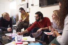 Designers Sitting On Sofa Having Creative Meeting In Office Kuvituskuvat