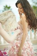 Gorgeous, lovely bride, mode with young friend preparing to wedding day. - stock photo