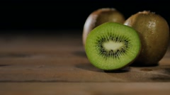 Kiwi on table black background dolly movement Stock Footage
