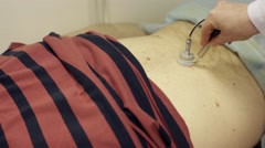 Laser Therapy on stomach of patient Stock Footage