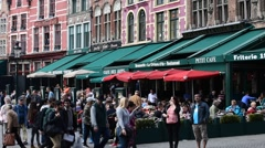 Pavement cafés along the Market square in Bruges, Belgium Stock Footage