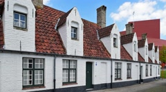 Alley with medieval almshouses and Concert Hall in Bruges, Belgium Stock Footage