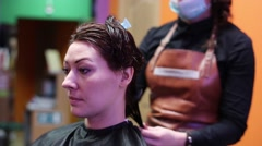 Hairdresser Mows Hair Tips - stock footage