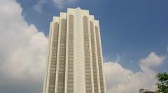 Skyscraper Menara Dayabumi against Clouds Motion Stock Footage
