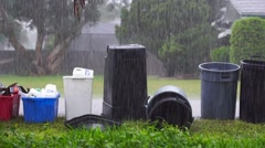 Recycling and Trash Cans During a Rain Storm Stock Footage