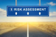 risk assessment words on blue road sign - stock photo