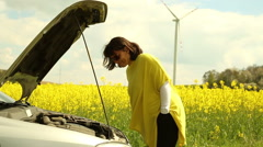 Woman with broken car in countryside - stock footage