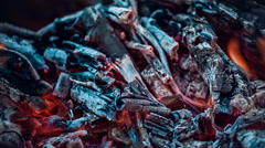 Burning coals with glowing fire streaks. Special effect - stock footage