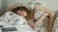 Young beauty woman waking up and using tablet in the bed early morning Stock Footage