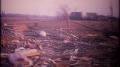 3284 aftermath of tornado damage shows destruction - vintage film home movie Stock Footage