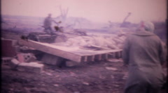 3283 homeowners inspect tornado damage to their farm - vintage film home movie Stock Footage