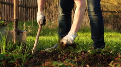 Weeding a garden beds at countryside - stock footage