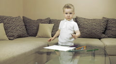 Child painting at the table Stock Footage