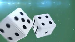 Pair of dice is rolling in slow motion against a green background Stock Footage
