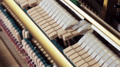 Piano mechanics in action exposed on upright piano while playing a fast song - stock footage