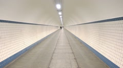 Long pedestrian tunnel antwerp Stock Footage
